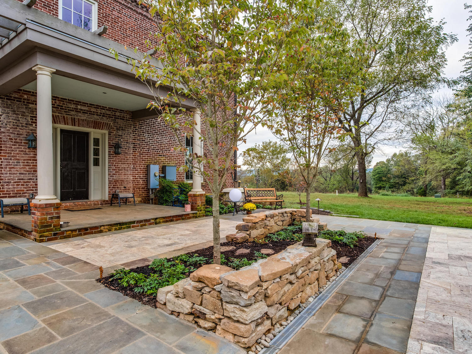patio landscape designed with stone walls travertine and flagstone