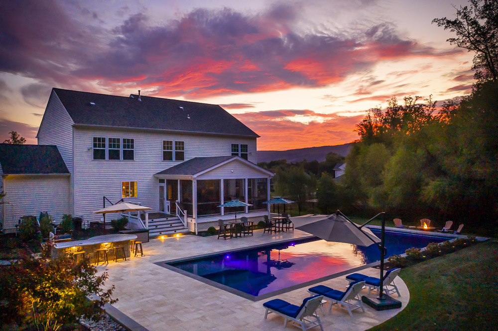 Pool and patio with landscape lighting