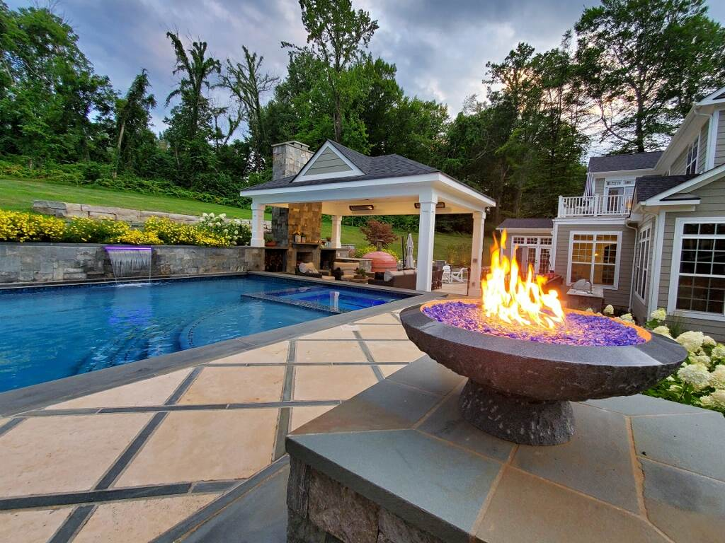 pool with retaining wall on sloped backyard