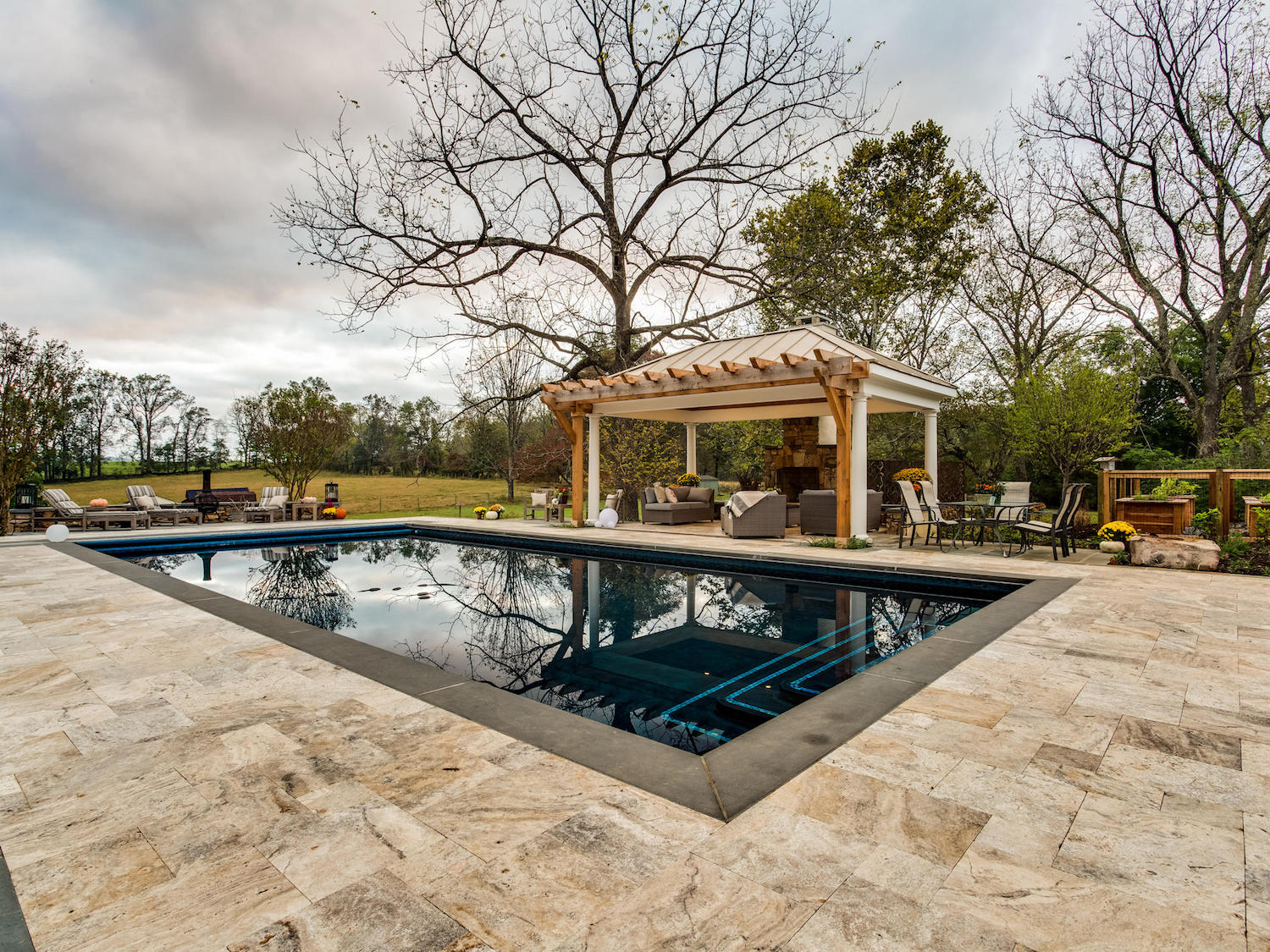 inground pool with pavilion and fireplace