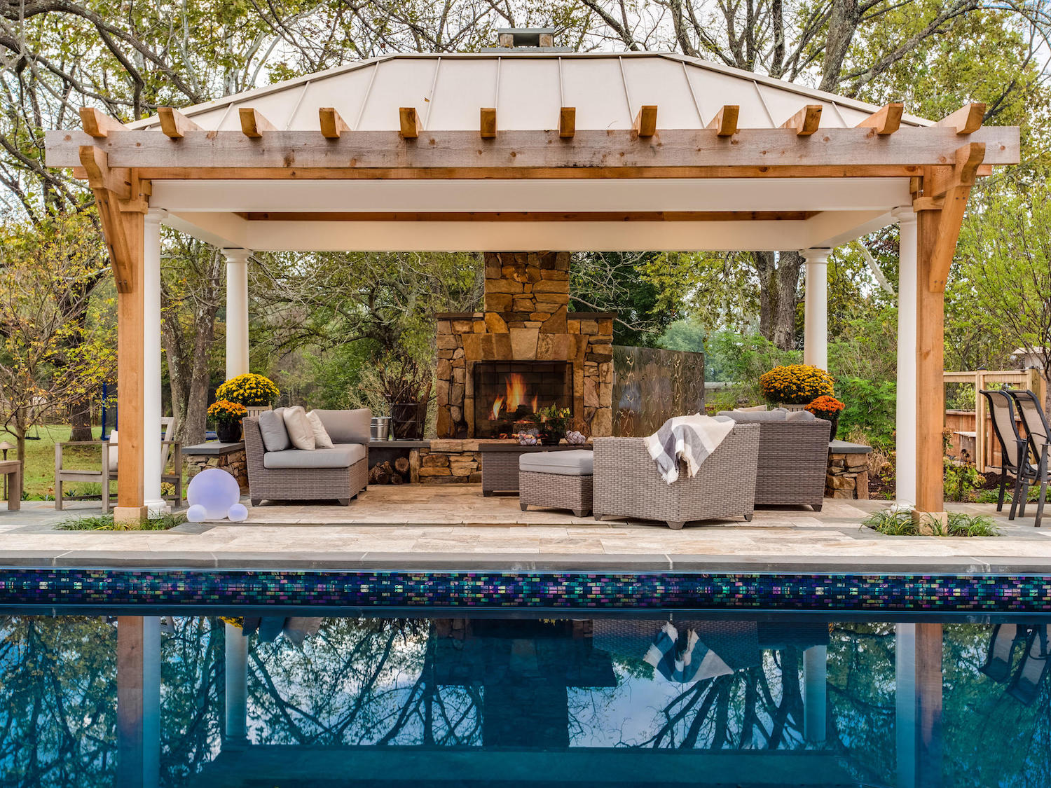 outdoor fireplace, pool, and pavilion landscape design in Warrenton, VA