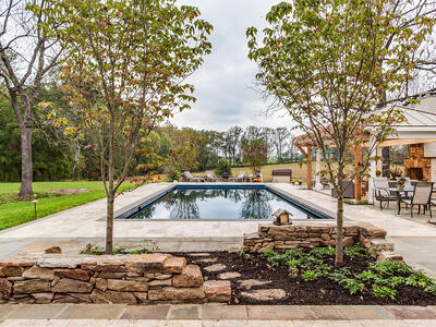 landscape design with pool, fireplace, pavilion, and patio in Warrenton, VA