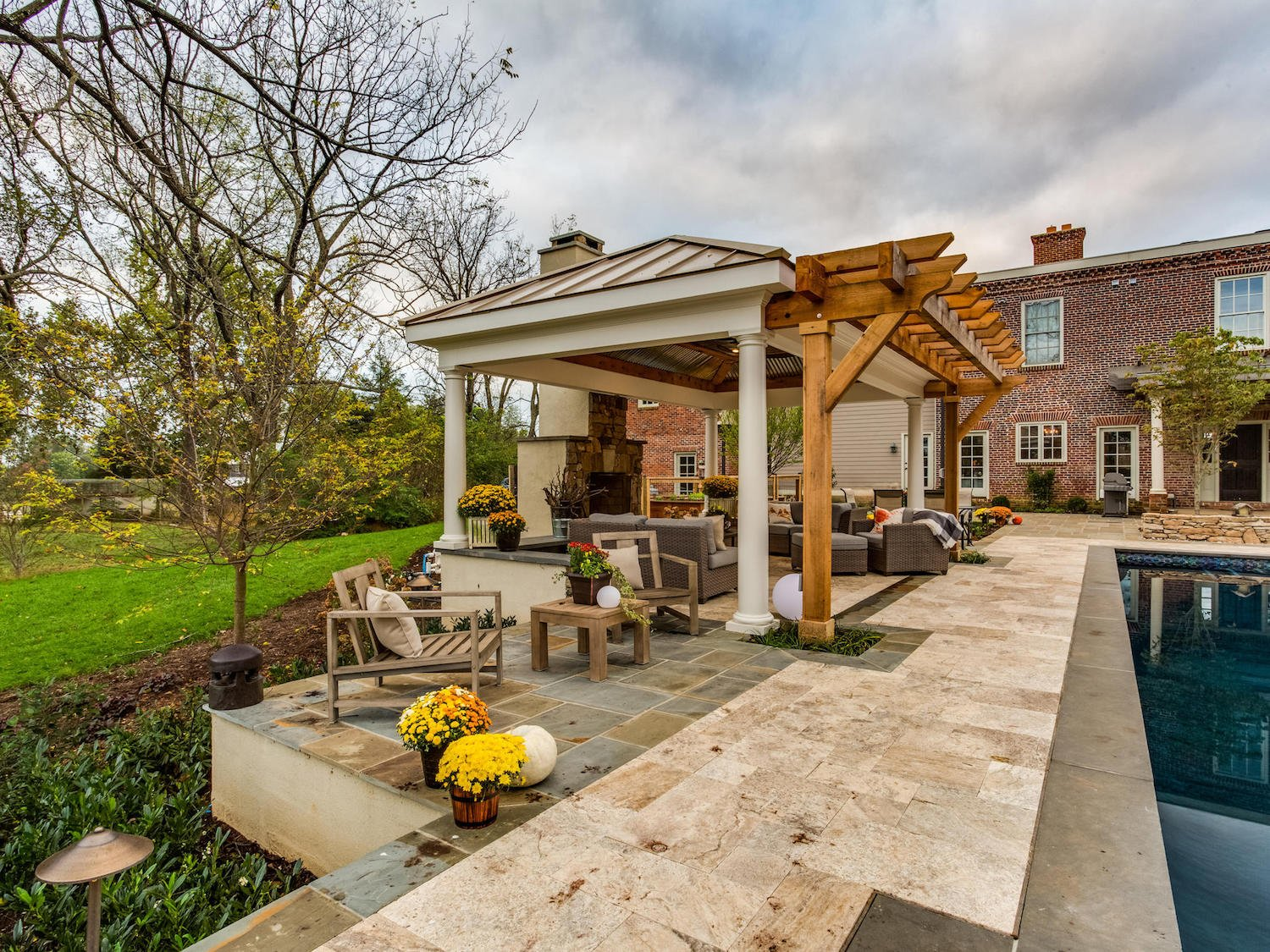 landscape design in Warrenton, VA with outdoor fireplace, pavilion, pool, and flagstone