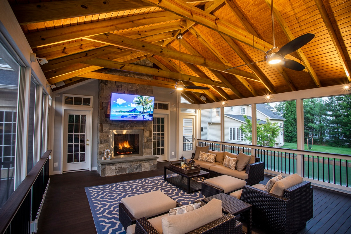 three seasons screened porch with TV and fireplace in Ashburn, VA