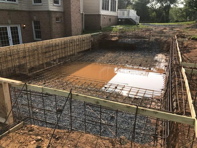 pool construction on sloped property