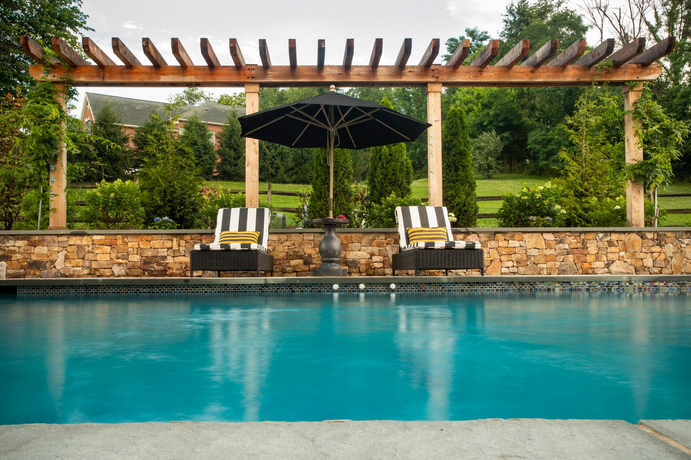 pool with stone wall